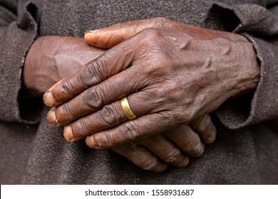 Hands of elderly woman in Uganda, Africa