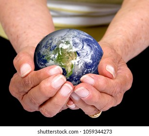 Hands of eldery woman holding an earth globe.