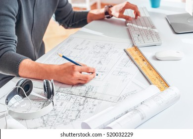 Hands of Engineer drawing on architectural project. Freelance work. Selective focus.