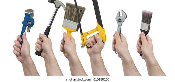 Hands facing left and holding various construction tools including a pipe wrench, hammer, paintbrush, hacksaw, an adjustable spanner, and a narrow paintbrush.