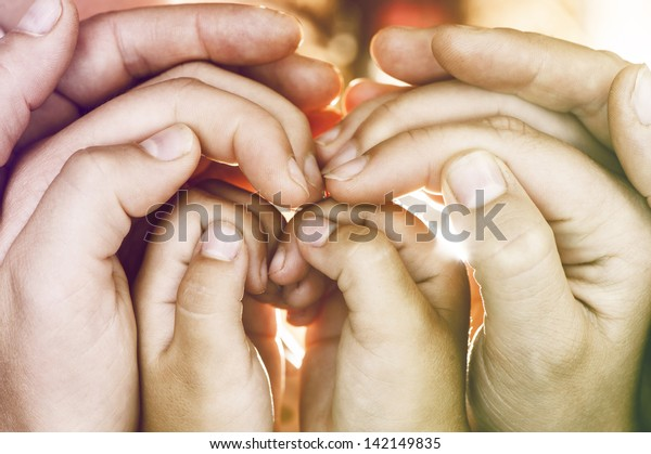 hands of  family in  conceptual position.
