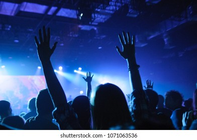 hands of fans raised up, during a concert, show or performance