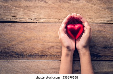 hands female giving red heart