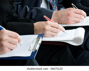 Hands filling in a form