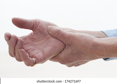 hands fist old person affected by arthritis, rheumatism