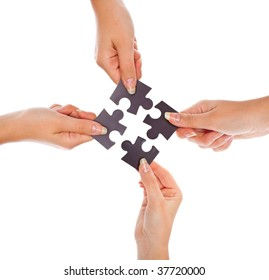 Hands with four puzzles. Isolated on white background