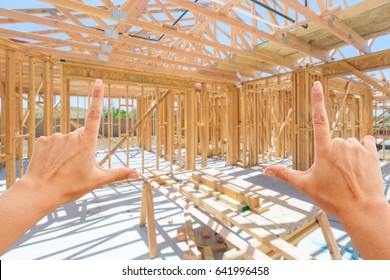 Hands Framing Inside New Home Construction Framing.