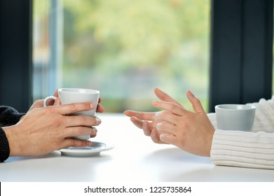 Hands of friends with cups and time for a coffee break