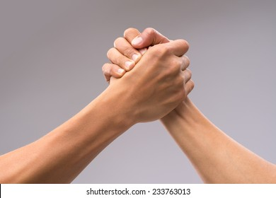 Hands of friends greeting each other