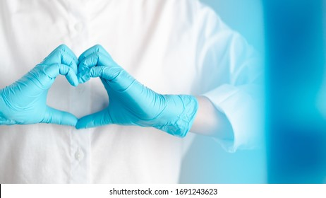 hands gesture of doctor wearing blue gloves, heart shape sign for love