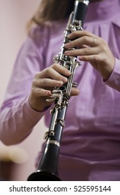 Hands girl playing the clarinet