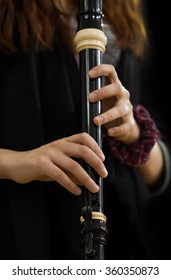 Hands girl playing of recorder