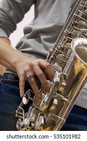 Hands girl playing the saxophone