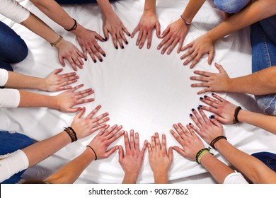 hands of girls form a circle