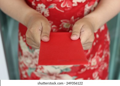 The hands Give Red gift money on Chinese New Year 2016