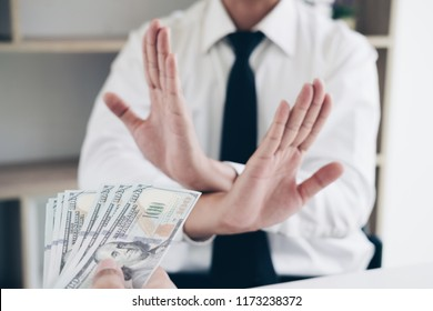 Hands giving bribe money and businessman refusing bribe money, Corruption in Business concept.