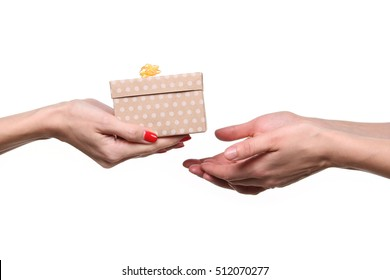 Hands giving and receiving a present gift isolated on white background