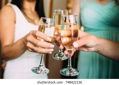 Hands with glasses of champagne