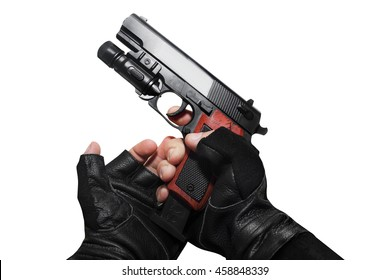 Hands in gloves reloading gun .Hands in leather gloves reloading a gun clip first person view isolated photo.