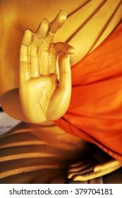 Hands of gold Buddha statue.