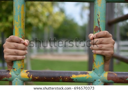 Hands Grab On Jungle Gym Children Stock Photo (Edit Now
