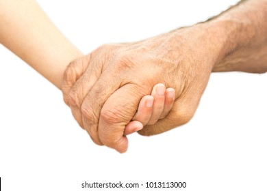 Hands of a grandfather and his grandson outdoors isolated in white