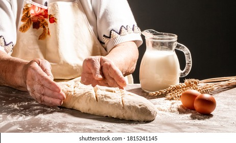 Hands of granny kneads dough. 80 years old woman hands kneading dough. homemade baking. Pastry and cookery.