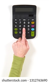 Hands in green jacket and black calculator on white background