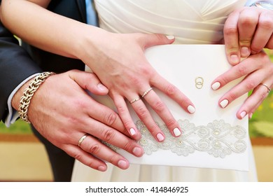 Hands of the groom and bride with rings