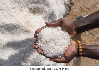 Hands with a handful of salt in the Palmarin mines in Senegal