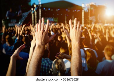 hands of happy people crowd having fun at stage at summer live rock fest