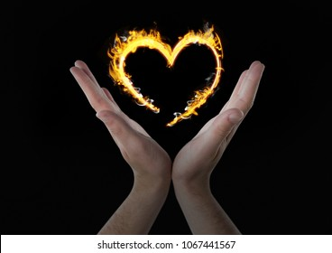 hands with heart fire icon over. Black background