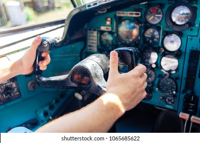 Hands at the helm of the plane. Aircraft Management