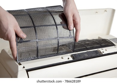 Hands hold the air conditioner filter, install the mesh after cleaning. Clean to get rid of any accumulated dirt