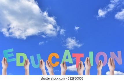 Hands Hold Colorful Word EDUCATION Banner.