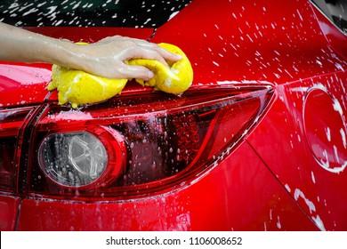 hands hold sponge for washing car, car concept.