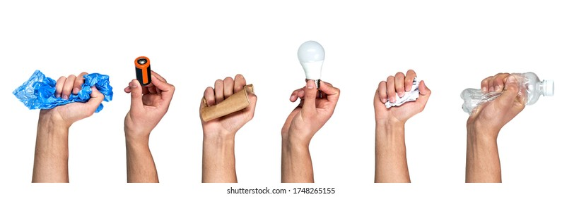 Hands hold trash on a gray background. The concept of separate trash, stop plastic, recycling.