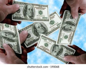 Hands holding a $100 dollar bills.