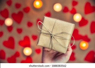 Hands holding beautiful gift box, female giving gift, Valentine's Day, holidays and greeting season concept, top view background romantic design