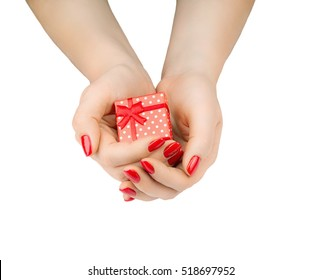 Hands holding beautiful red gift box, female giving gift, Christmas holidays and greeting season concept, closeup, isolated on white background. Beautiful red manicure