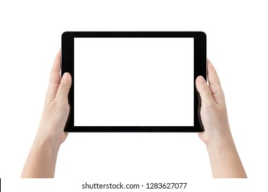 Hands holding black tablet computer and blank white screen on table with clipping path.