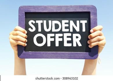 Hands holding blackboard with handwritten  student offer
