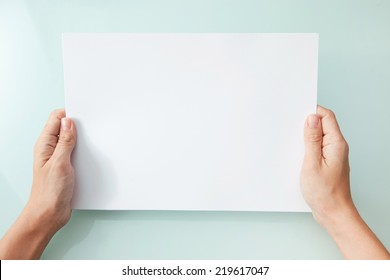 hands holding blank A4 copy space letter