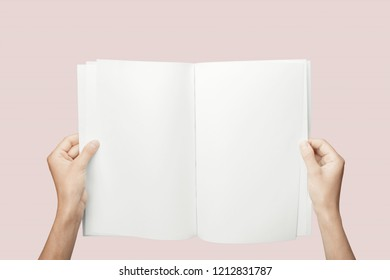Hands holding  blank book isolated on  background