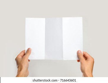 Hands holding blank brochure booklet in the hand. Leaflet presentation. Pamphlet hand man. Man show offset paper. Sheet template. Book in hands. Booklet folding design. Fold paper sheet display read.