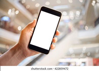hands holding blank screen of smartphone device in department store.