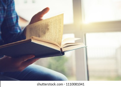 hands holding book and reading
