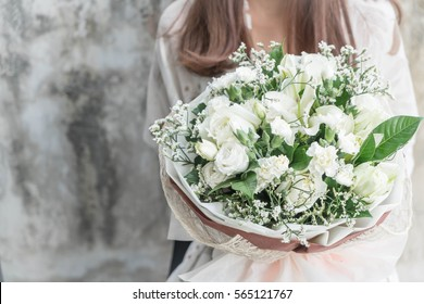 Hands holding bouquet of flower - vintage lighting style