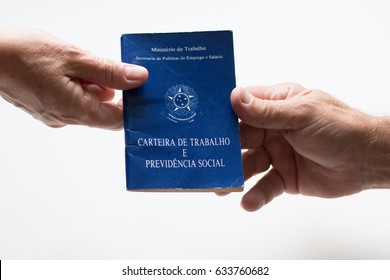 Hands holding brazilian document work with white background