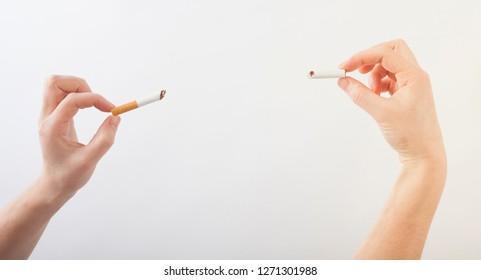 hands holding broken cigarette. quit smoking concept
